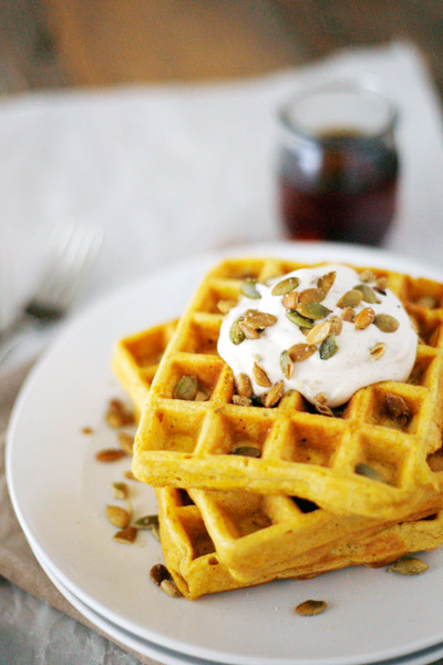Pumpkin Spice Waffles with Maple Cream and Pepitas | BourbonAndHoney -- Pumpkin Spice Waffles, a great weekend breakfast made with pumpkin puree and topped with maple cream, syrup and toasted pepitas.