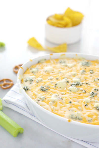Beer Cheese Buffalo Chicken Dip | BourbonandHoney.com -- The perfect game day dip, this Beer Cheese Buffalo Chicken Dip is spicy, cheesy and guaranteed to be a crowd pleaser!