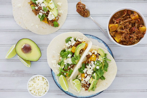 Slow Cooker Sweet Potato and Pulled Pork Tacos | BourbonAndHoney.com