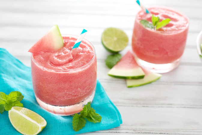 Watermelon Tequila Slush | BourbonandHoney.com -- This frosty, boozy and pretty pink Watermelon Tequila Slush cocktail is a tasty and refreshing way to keep you cool all summer long.