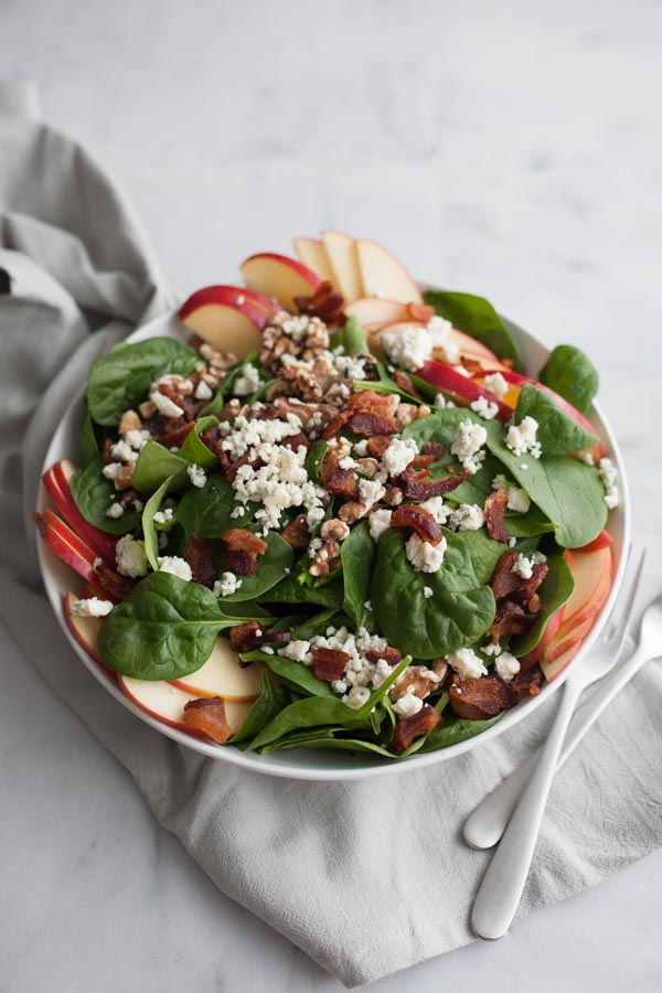 Apple, Blue Cheese and Bacon Chop Salad | BourbonandHoney.com -- This chopped bacon and blue cheese salad is packed with fresh apples, crumbled blue cheese, crispy bacon topped with a dijon vinaigrette.