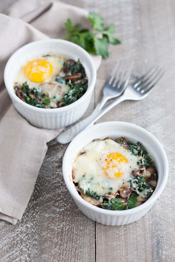 Baked Eggs with Kale and Mushrooms | BourbonandHoney.com -- These creamy, indulgent Baked Eggs with Kale and Mushrooms are perfect for a lazy weekend breakfast.