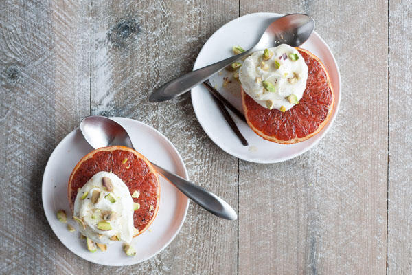 Broiled Grapefruit with Honey Yogurt and Pistachios | BourbonandHoney.com -- Fresh, citrusy and caramelized, this Broiled Grapefruit with Honey Yogurt is a delicious breakfast, snack or sweet treat.