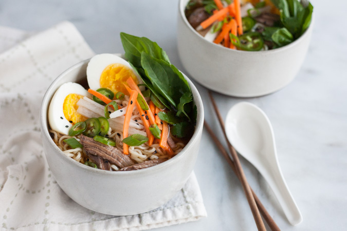 Slow Cooker Ramen | BourbonandHoney.com -- The complex flavors of ramen are made easy with this Slow Cooker Ramen recipe with all the yummy toppers you could want!