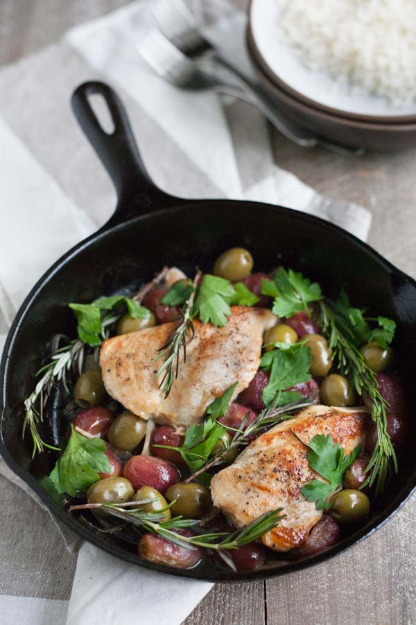 Skillet Chicken with Olives and Rosemary | BourbonandHoney.com -- This flavorful and delicious Skillet Chicken with Olives and Rosemary is an impressive dinner recipe for guests and an easy weeknight meal!