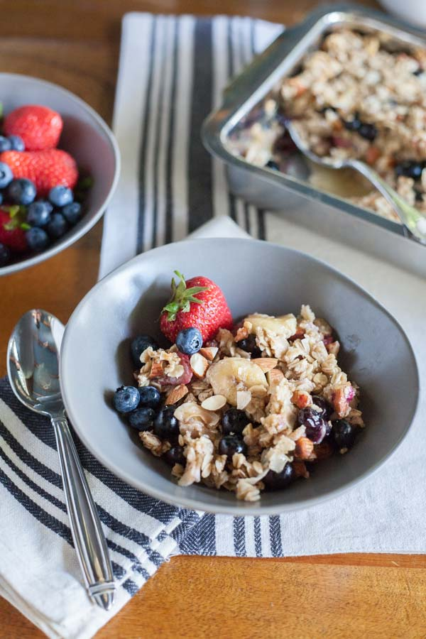 Coconut Baked Oatmeal with Berries | BourbonandHoney.com -- A warm, fruity and hearty Coconut Baked Oatmeal with Berries, almonds and bananas. It's the perfect recipe for a lazy weekend brunch!
