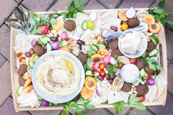 Ultimate Mediterranean Hummus Platter | BourbonandHoney.com -- Ultimate Mediterranean Hummus Platter | BourbonandHoney.com -- This Mediterranean Hummus platter is the ultimate party appetizer. No need to make anything from scratch, just throw together your favorite ingredients for a seriously simple yet impressive snack.