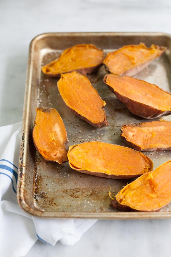 Greek Baked Sweet Potatoes | BourbonandHoney.com -- These simple Greek Baked Sweet Potatoes are a hearty, healthy and flavorful weeknight recipe or a great brown bag lunch.