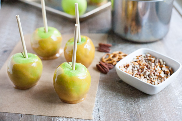 Bourbon and Honey Caramel Apples | BourbonandHoney.com -- Sweet, spiked and perfect for a chilly fall, these Bourbon and Honey Caramel Apples are a great homemade sweet treat or snack!