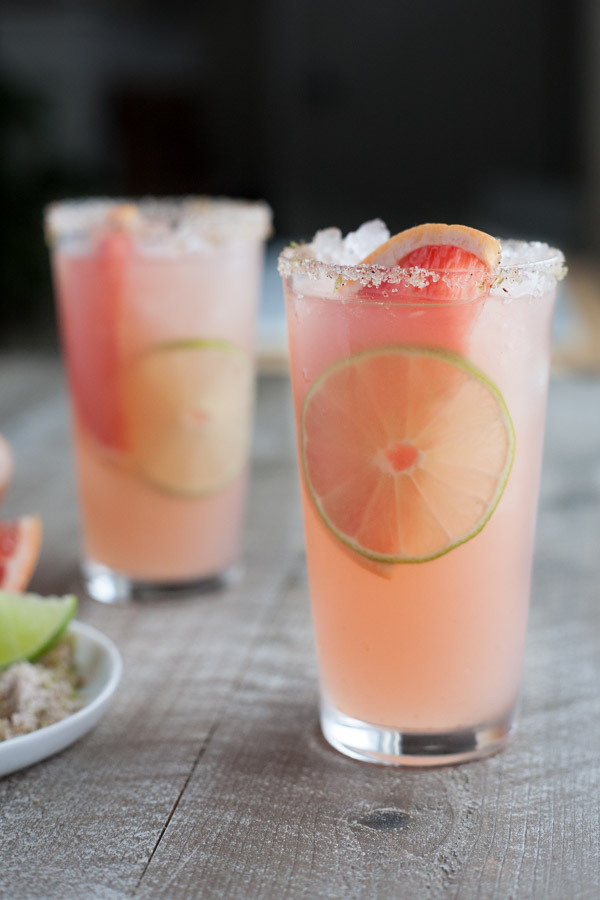 Paloma Cocktail with Chili Lime Salt | BourbonandHoney.com -- Fresh, citrusy and boozy, this bubbly Paloma Cocktail is a refreshing tequila drink with chili lime salt, it packs a punch!