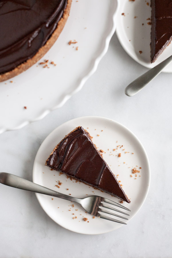 Bourbon and Honey Chocolate Tart | BourbonandHoney.com -- With a splash of bourbon, a drizzle of honey and a pretzel-graham cracker crust, this indulge chocolate tart is the perfect recipe for any chocolate lover!