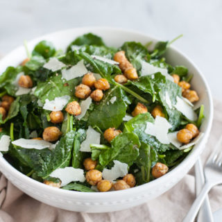 Baby Kale Salad with Crispy Parmesan Chickpeas | BourbonandHoney.com -- Simple, flavorful and impossibly easy, this Baby Kale Salad with Crispy Parmesan Chickpeas recipe is my go-to for both weeknight meals and dinner parties.