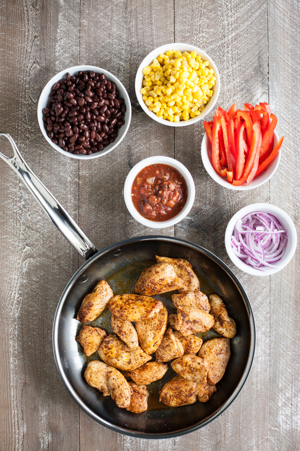 Easy Skillet Chicken with Black Beans and Corn | BourbonandHoney.com -- Spicy, delicious and on the table in 20 minutes, this Easy Skillet Chicken recipe is a serious weeknight winner and a quick family favorite!