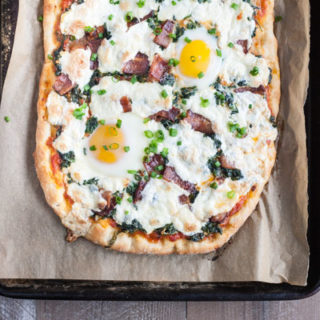Bacon and Egg Burrata Breakfast Pizza | BourbonandHoney.com -- Start your morning right with this Bacon and Egg Burrata Breakfast Pizza recipe. It's cheesy, bacon-y and top with perfectly cooked eggs.