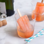 Boozy Aperol Spritz Popsicles | BourbonandHoney.com -- These slightly boozy Aperol Spritz Popsicles are the perfect recipe to cool down during the heat of summer, especially when served with a splash of Prosecco!
