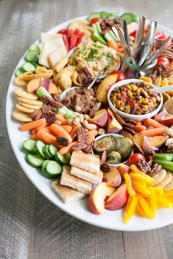 Southern Pimento Cheese Appetizer Tray | BourbonandHoney.com -- Packed with fruit, veggies, crackers and lot of cheese, this Southern Pimento Cheese Snack Tray is quick to make and can serve a crowd!