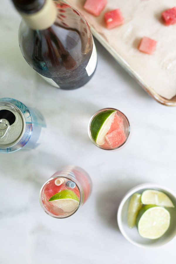 Fresh Watermelon White Wine Spritzer | BourbonandHoney.com -- This simple, refreshing and low alcohol white wine spritzer is chilled with frozen watermelon for the perfect warm weather cocktail.