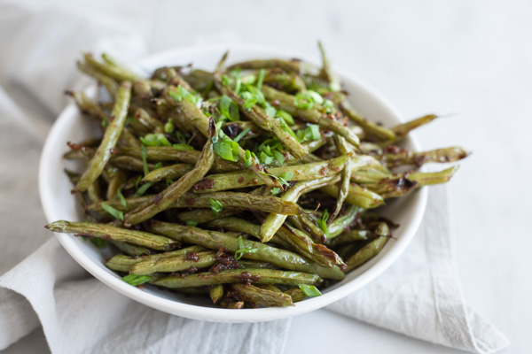 Spicy Szechuan Green Beans | BourbonandHoney.com -- Quick, spicy and totally delicious, these Szechuan Green Beans are the perfect side dish for a dinner party or a weeknight dish.